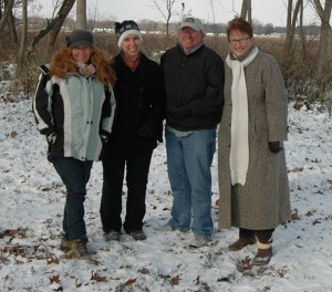 Heather Harwood, Wawasee Area Conservancy Foundation; Syracuse-Wawasee Trails Executive Director Megan McClellan; Sam Leman, WACF Chairman; and Kay Young, Wawasee Property Owners Association President , are shown on the site of a trail to be installed on WACF property. (Photo by Chelsea Los & courtesy of  Ink Free News )